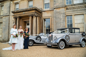 Wedding Party in Front of Normanby Hall by One Click Photographer